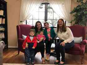 Midwife Lynneece Rooney, CNM with client, baby and siblings