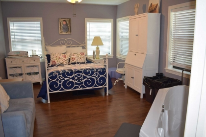 Each birth room offers a large bed for both parents to enjoy cuddling with the new baby.